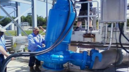 Workers utilizing a Keen Pump Machine sold at Caribbean Basin Enterprises